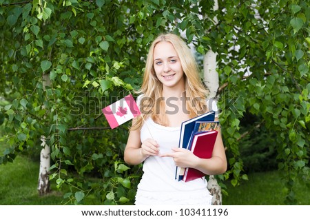 Portrait of a blond girl with Canadian flag - stock photo