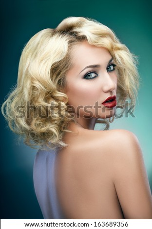 Portrait of a blond woman turning around, shot from a back - stock photo