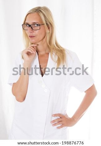 portrait of a blond woman with glasses in a white overall