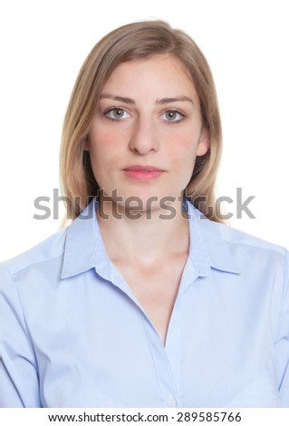Portrait of a blonde german woman in blue blouse - stock photo