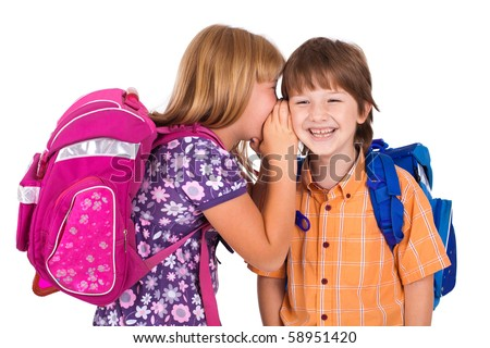 portrait of a blonde girl whispering in boy's ear , isolated on white - stock photo