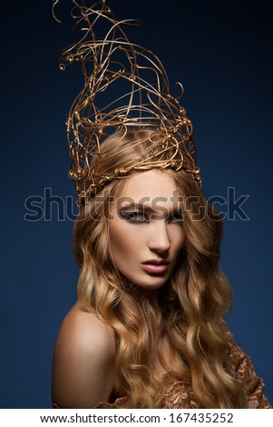 Portrait of a blonde with wire crown on head - stock photo