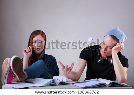 Portrait of a bored teenage students in classroom - stock photo