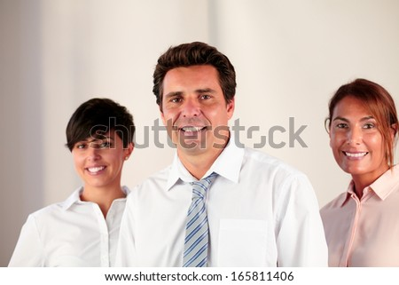 Portrait of a boss team smiling and looking at you while standing