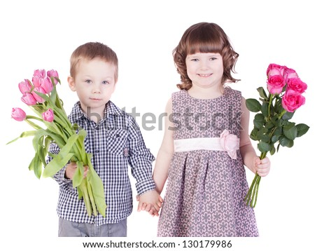 portrait of a boy and girl holding flowers in their hands. white background, isolated.