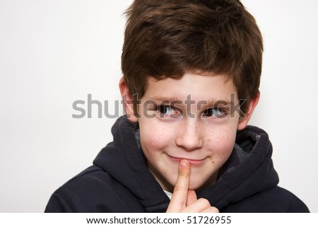 Portrait of a boy, facial expression series. - stock photo