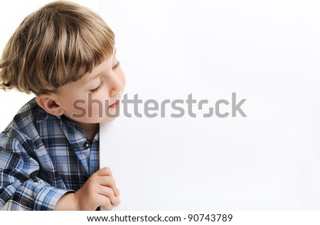 Portrait of a boy holding blank billboard or large white sheet of paper - stock photo