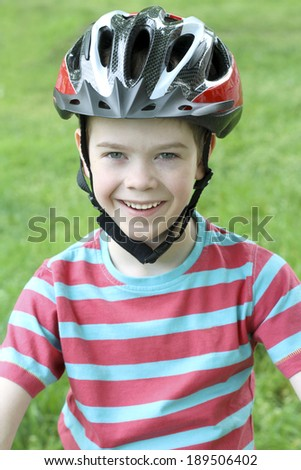 Portrait of a boy in bicycle helmet