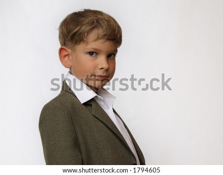 Portrait of a boy in business suit - stock photo