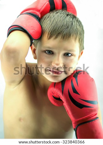 Portrait of a boy in red boxing gloves