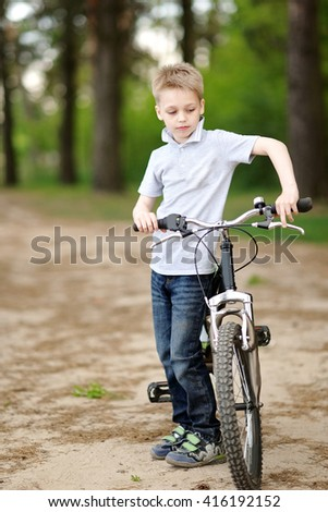 Portrait of a boy in the summer outdoors - stock photo