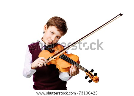 Portrait of a boy playing his violin. Isolated over white background. - stock photo