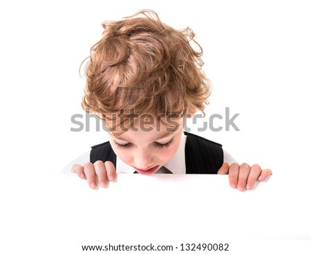 Portrait of a boy six years in the studio - stock photo