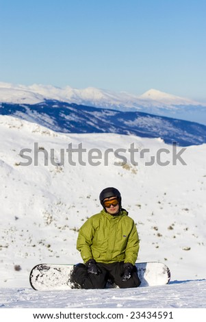 portrait of a boy snowboarding - stock photo