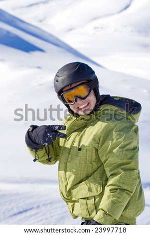 portrait of a boy snowboarding