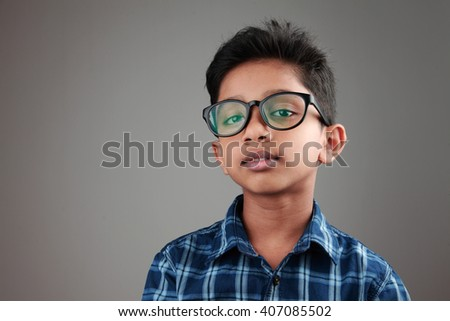 Portrait of a boy wearing a big spectacle  - stock photo