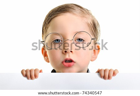 Portrait of a boy wearing glasses and holding blank billboard or large white sheet of paper