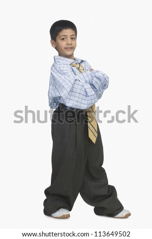 Portrait of a boy wearing oversized clothes - stock photo