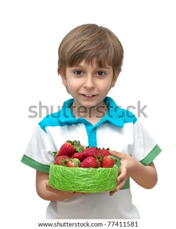 Portrait of a boy with a bowl of strawberries in the hands - stock photo