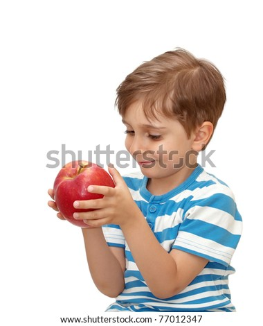 Portrait of a boy with an apple in his hand - stock photo