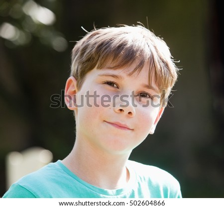 Portrait of a Boy with Brown Hair Outdoors