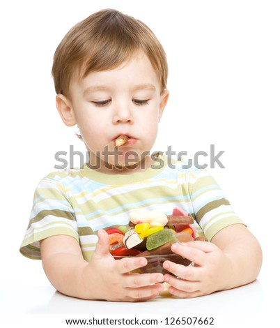 Portrait of a boy with cookies, isolated over white - stock photo