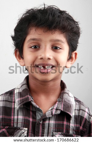 Portrait of a boy without some teeth - stock photo