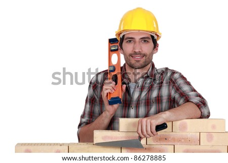Portrait of a bricklayer - stock photo