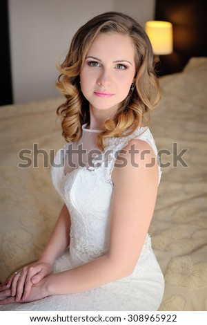 Portrait of a bride in a hotel room.