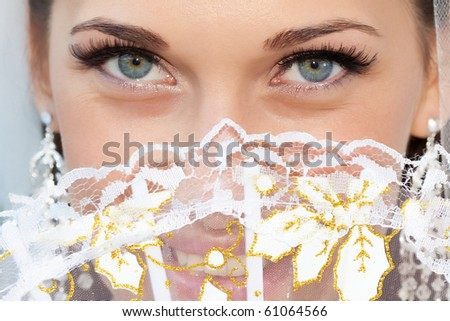 Portrait of a bride with a fan - stock photo