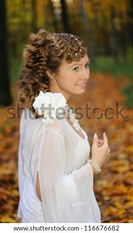 Portrait of a bride with long hair braided in plaits