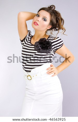 portrait of a bright and fashion young woman - stock photo
