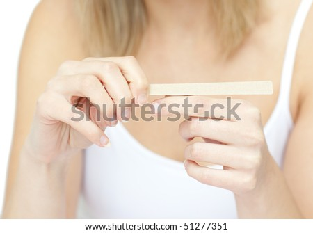 Portrait of a bright woman filing her nails against a white background