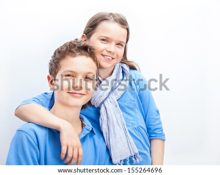 Portrait of a Brother and Sister, both wearing a blue shirt