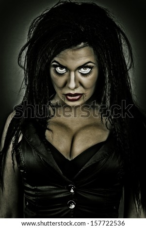 Portrait of a brunette woman with creepy look