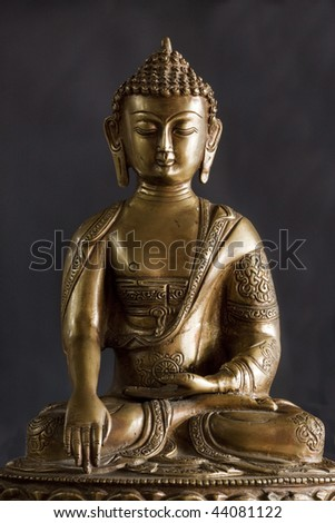 Portrait of a buddha statue with black background. - stock photo