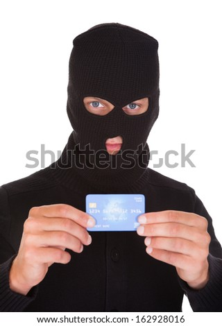 Portrait Of A Burglar Putting Credit Card - stock photo