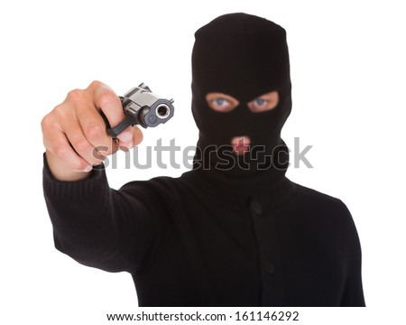Portrait Of A Burglar With Balaclava Holding Hand Gun Isolated On White Background