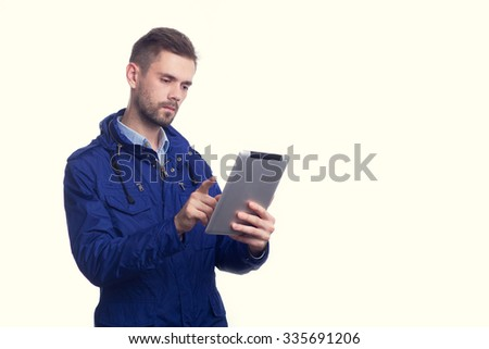 Portrait of a business guy writing in his organizer - stock photo