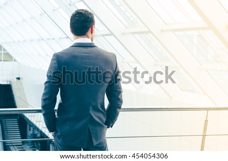 Portrait of a business man at office building - stock photo