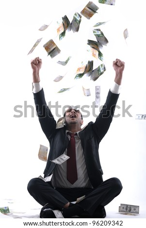 Portrait of a business man holding and catch falling money bills, isolated on white background in studio - stock photo