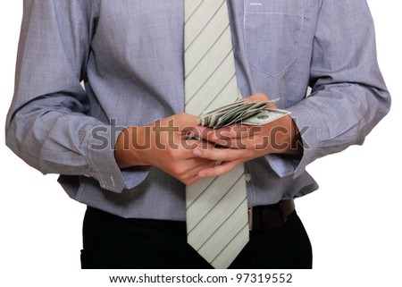 Portrait of a business man holding money - stock photo