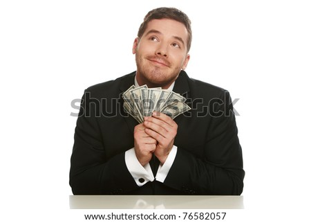 Portrait of a business man holding money, isolated on white - stock photo
