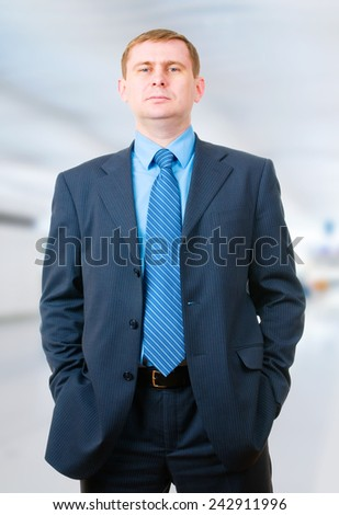 Portrait of a business man in the office - stock photo