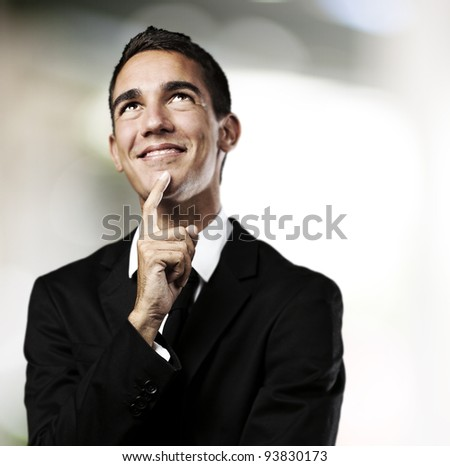 portrait of a business man thinking against an abstract background - stock photo