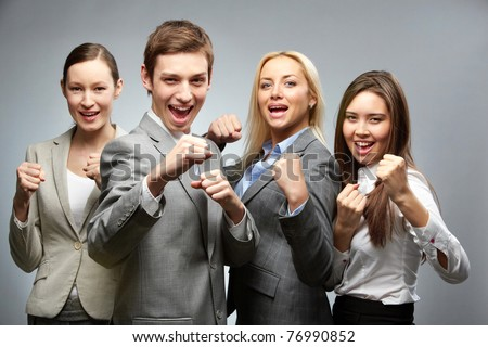 Portrait of a business team in boxing pose - stock photo