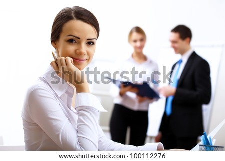 Portrait of a business woman in office environment - stock photo