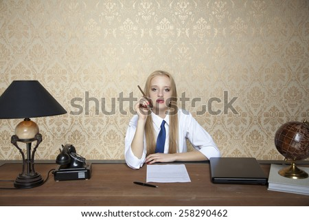 Portrait of a business woman with a cigarette - stock photo