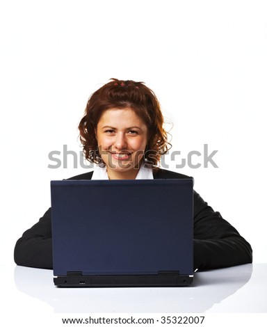 Portrait of a business woman working on a laptop over white background