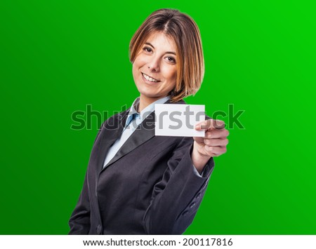 portrait of a business young woman showing her visit card - stock photo